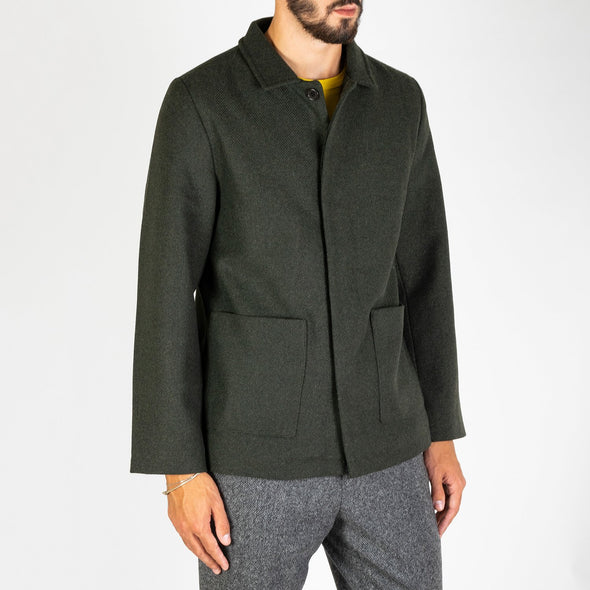 A classic coach style jacket made from a wool mix fabric.