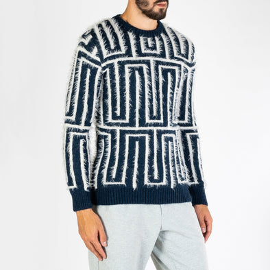 Two-tone jacquard knit made from a two ply knit of mohair-mix yarn.