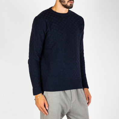 A long sleeve crew neck knit made from a three ply yarn of wool mix.