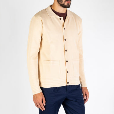 Casual, 2 pocket cardigan with ribbed detailing that adds a great mid-century feel.