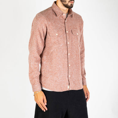 A long sleeved, workwear inspired shirt in a melange cotton fabric.