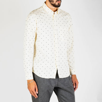 A long sleeved, casual button down shirt in a repeat factory design.