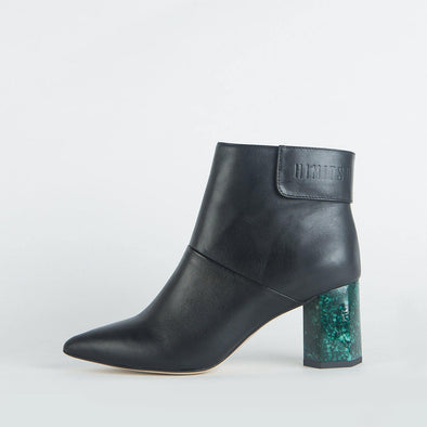 Black leather pointed toe ankle boots with a green patterned geometric heel.