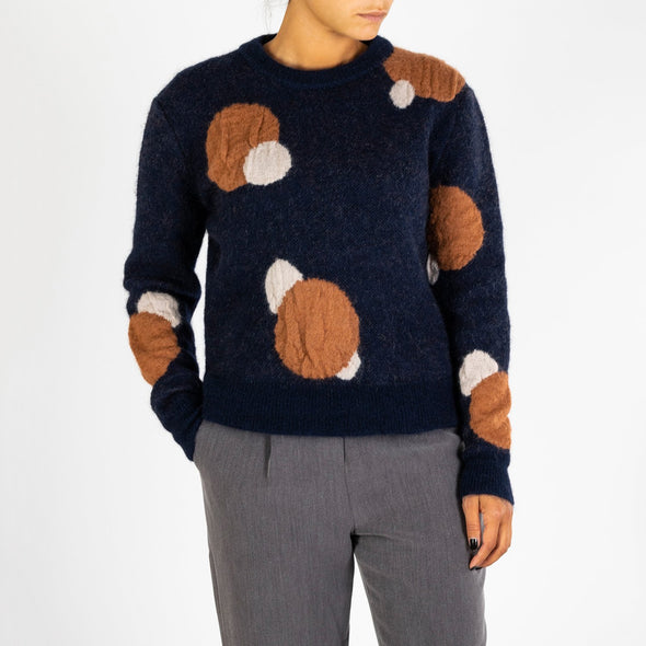 Sweater made of super soft wool with intarsia polka dots in contrasting rust and cream.