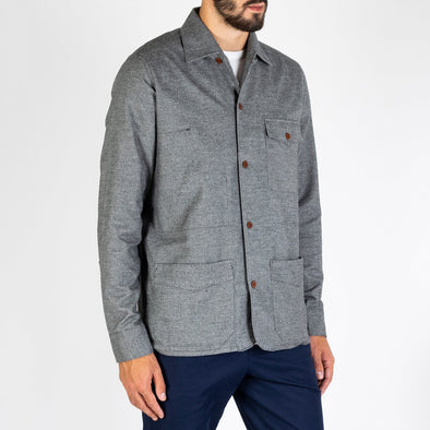 Soft grey flannel with 5 button closure made from natural corozo nut.