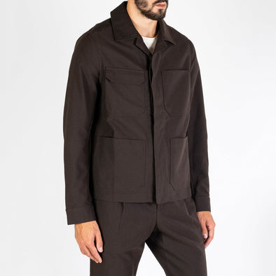 Workwear jacket in brown italian fabric featuring four front pockets.