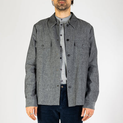 Grey melange fine Italian thick flannel jacket with two front pockets.