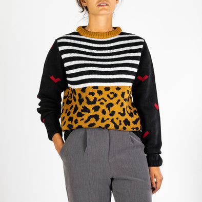 Multicolored knit presenting three different patterns: stripes, animal prints and red hearts.