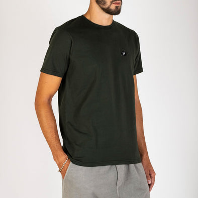 "Hunter green t-shirt with the brand's ""Essential"" patch on the chest."