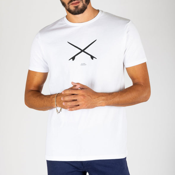 White t-shirt with crossed surfboards print on the front.