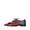 Red leather shoes which represent the male and feminine universes in perfect harmony.