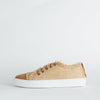 Brown leather low top sneakers with varge and jute details.