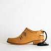 Camel leather shoes with golden details in leather and bronze rivets.