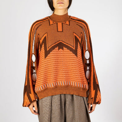 Bat sweater with an old School pattern in brown, orange and white.