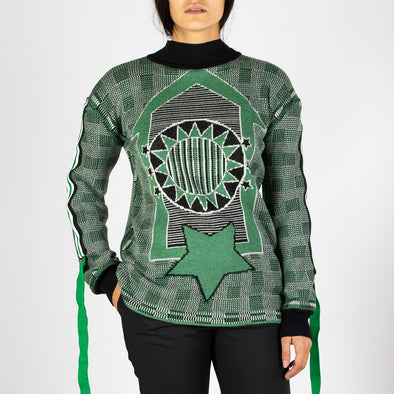 Jacquard long sweater in green, black and white with detailed sleeves.
