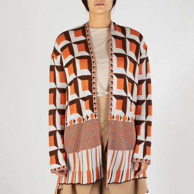 Long sleeved jacquard kimono with cube pattern in orange, brown and white.