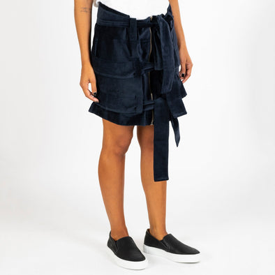 Navy blue velvet skirt with three straps which tie at the front.