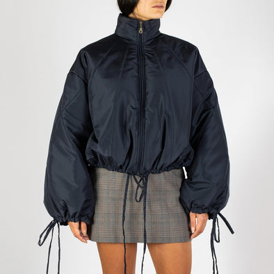 Short navy blue puffer jacket with distinct baloon sleeves.