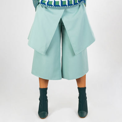 Aqua asymmetric culotte with overlapped skirt.