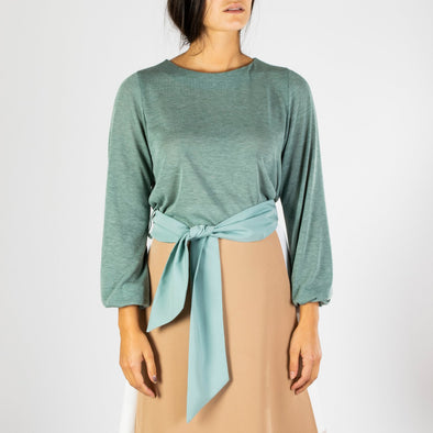 Super soft knit short shirt with a fabric belt and an elastic band on the fist.