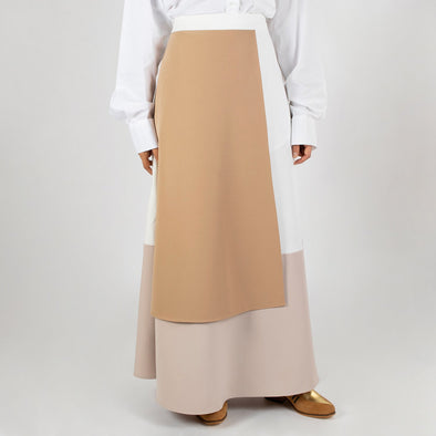 Elegant color block long skirt in neutral tones.