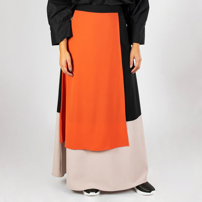 Elegant color block long skirt in black, orange and beige.