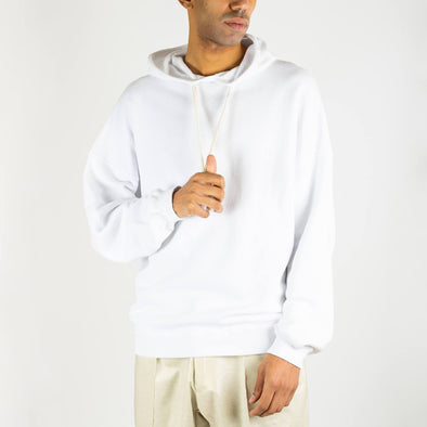 White long-sleeved hoodie with beige drawstrings.