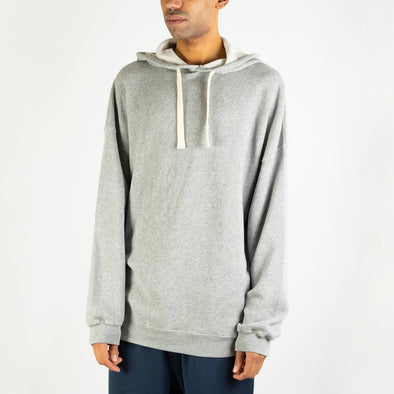 Grey long-sleeved hoodie with white drawstrings.