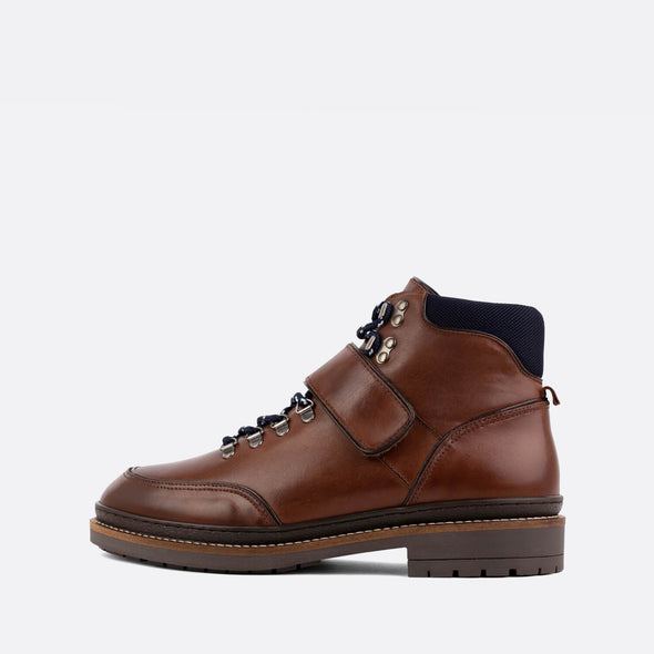 Brown leather lace-up boots with navy blue details.