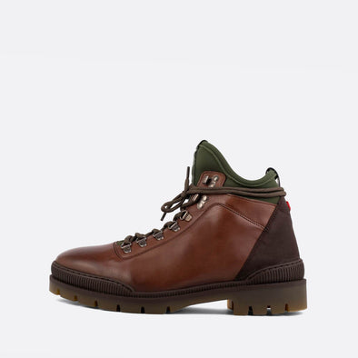 Brown leather lace-up boots with green neoprene detail.