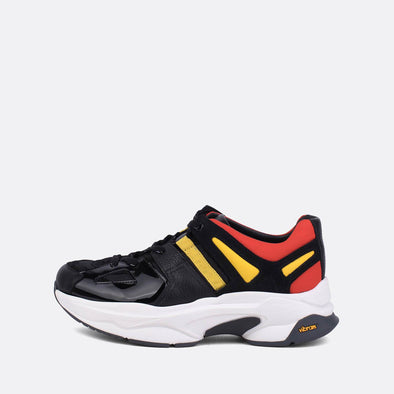 Edgy runners in black, red and yellow leather.