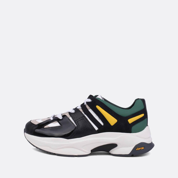Edgy runners in black, green and yellow leather.