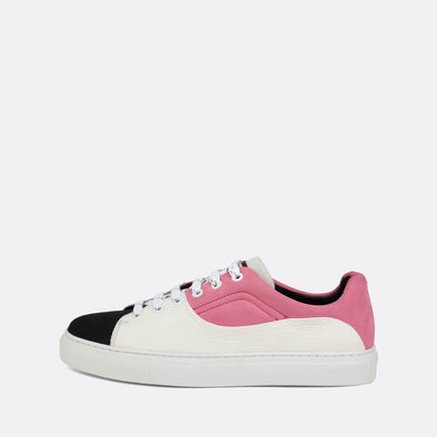 Black, white and pink low-top sneakers in leather and suede.