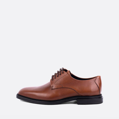 Unisex brown leather derby shoes.