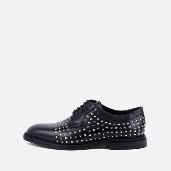 Black leather derby shoes with silver studs.