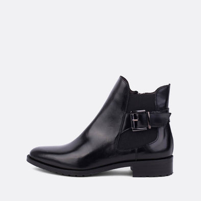Black leather flat chelsea boots with buckle.