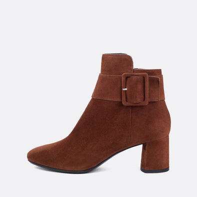 Brown suede ankle boots with large buckle.