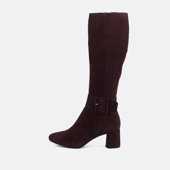 Brown suede heeled tall boots with large buckle.