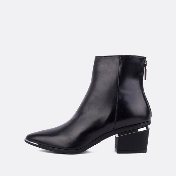 Black leather heeled ankle boots with silver detail.