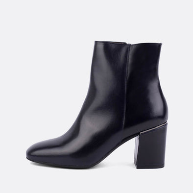 Black leather heeled ankle boots.