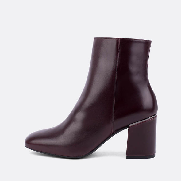 Bordeaux leather heeled ankle boots.