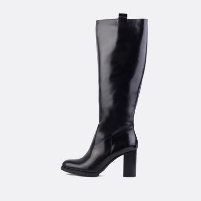 Black leather heeled tall boots with chunky heel.