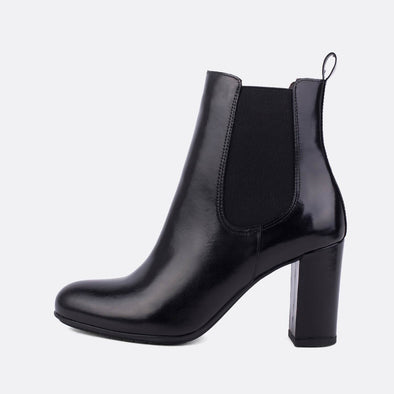 Black leather heeled chelsea boots.