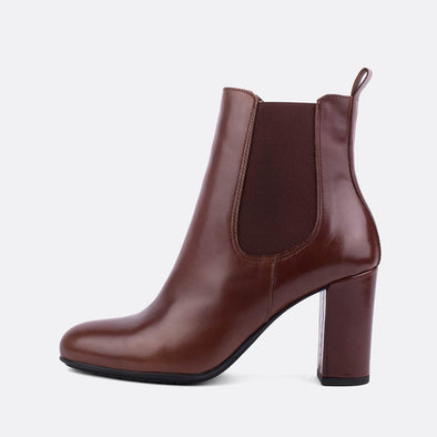 Brown leather heeled chelsea boots.