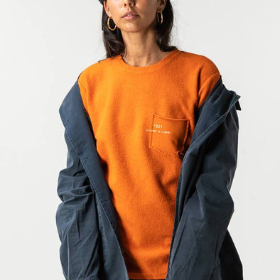 Orange urban pullover in 'inside-out' rustic style.