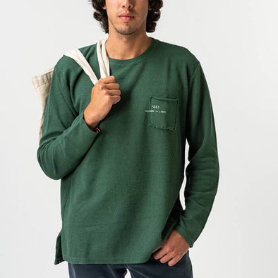 Green urban pullover in 'inside-out' rustic style.
