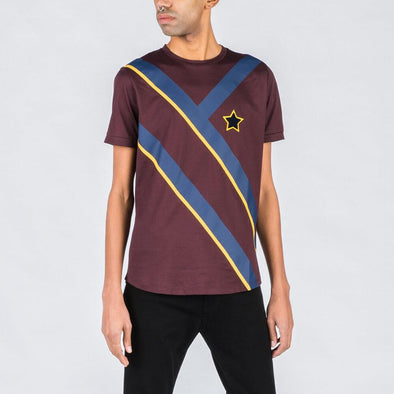 Burgundy t-shirt with navy blue and yellow details.