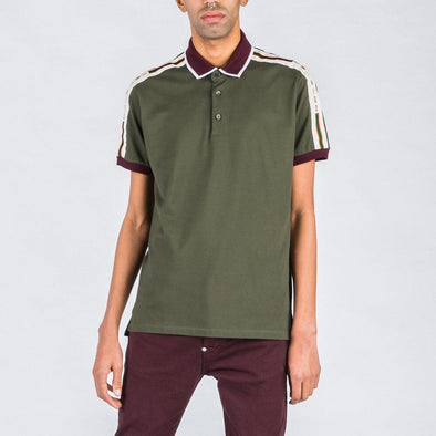 Olive green polo with burgundy and white details.