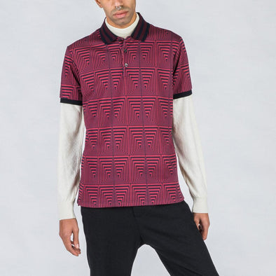 Burgundy and black patterned polo with detailed collar.