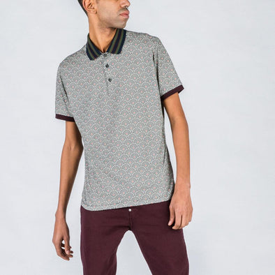 Multicolored patterned polo with detailed collar.